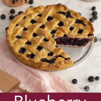 blueberry pie on counter with pink napkin