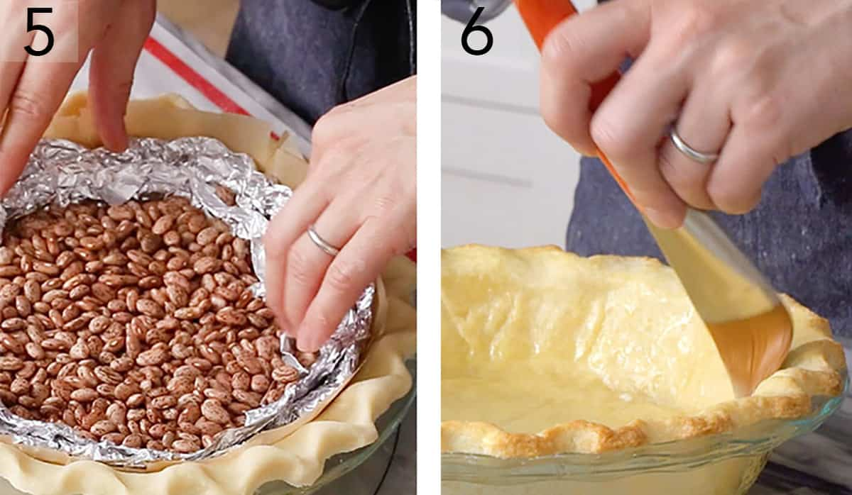 A butter crust being blind baked with pie weights.