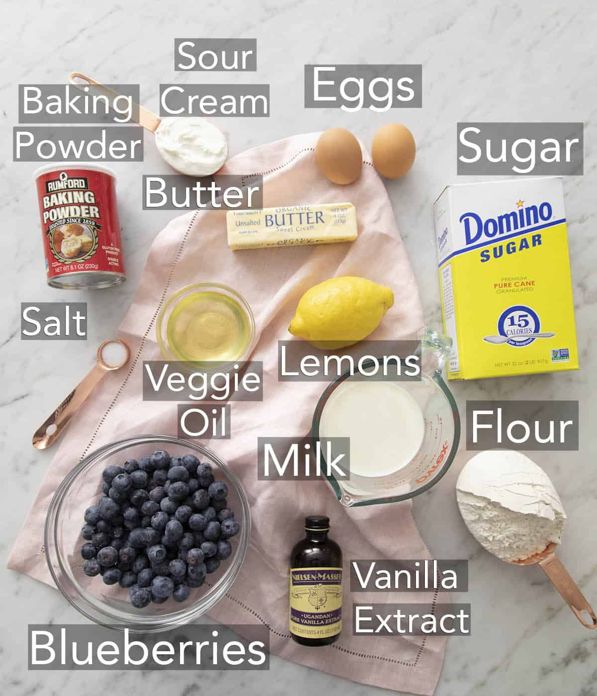 Ingredients for making blueberry muffins on a counter.
