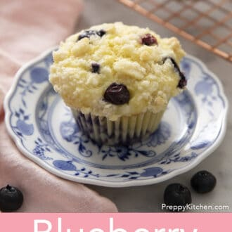 A Blueberry Muffin on a blue and white plate.