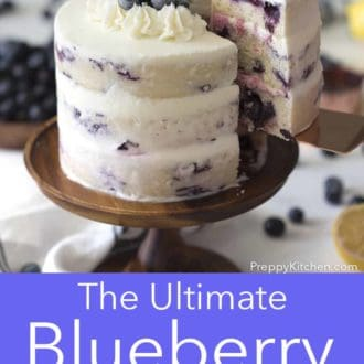 three layer lemon blueberry cake on a cake stand