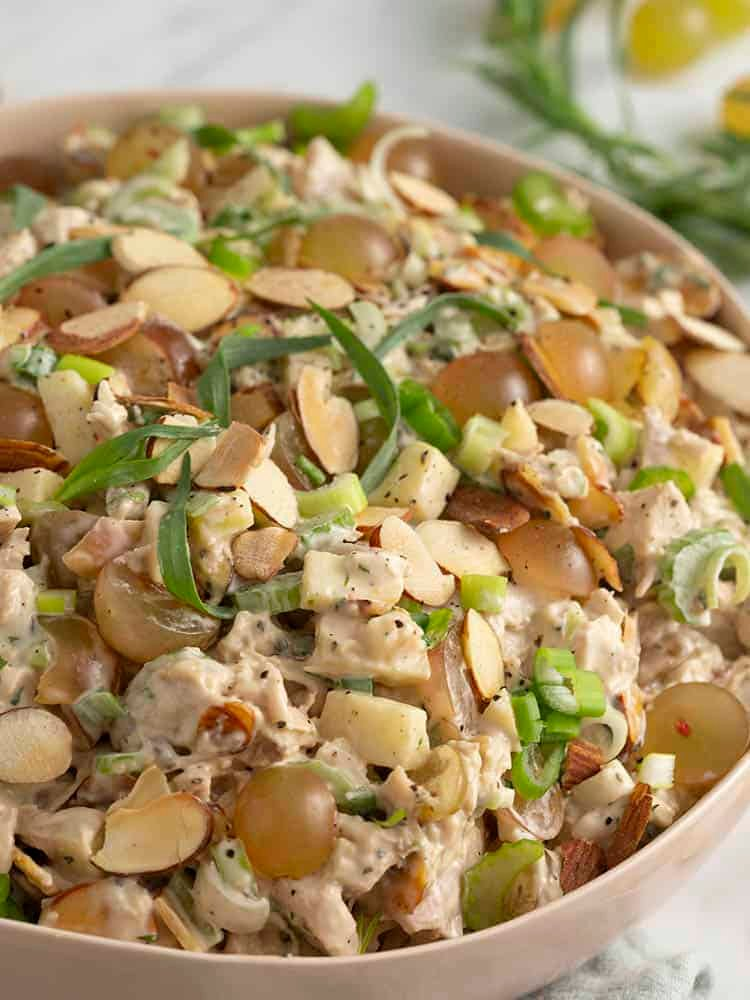 A bowl of chicken salad with grapes and fresh tarragon