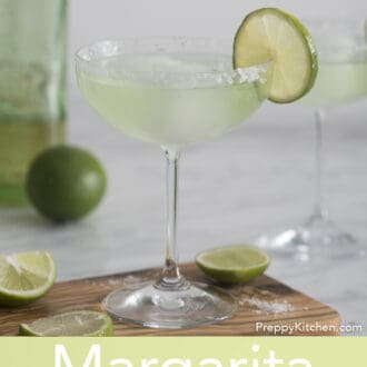 Margarita in a stemmed glass garnished with lime