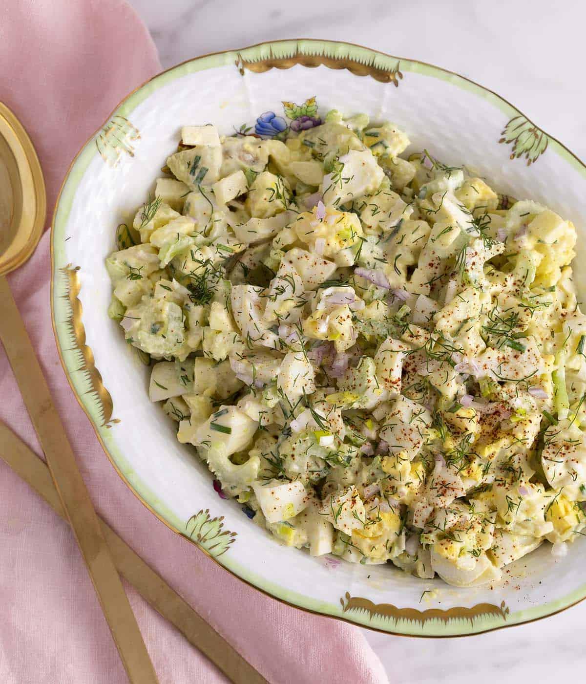 A big porcelain bowl of egg salad.