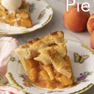 A big piece of peach pie on a porcelain plate.