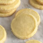 Butter cookies on a white marble table with sugar scattered around