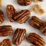 Candied pecans on a white marble surface