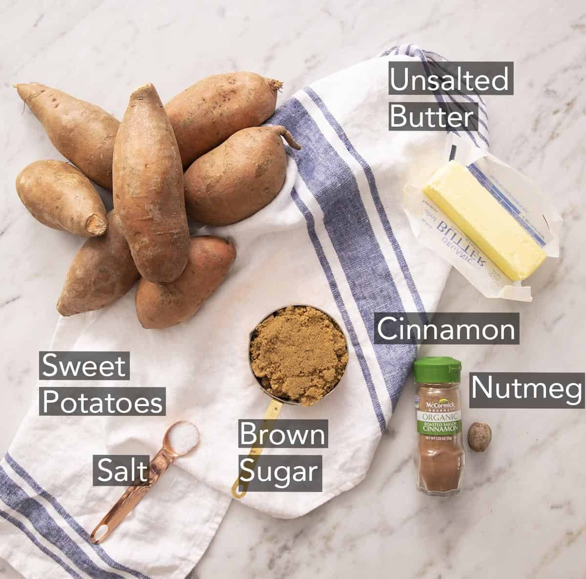 Ingredients for making candied yams on a marble counter.