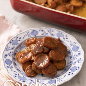 Candied Yams on a plate next to a red baking dish.