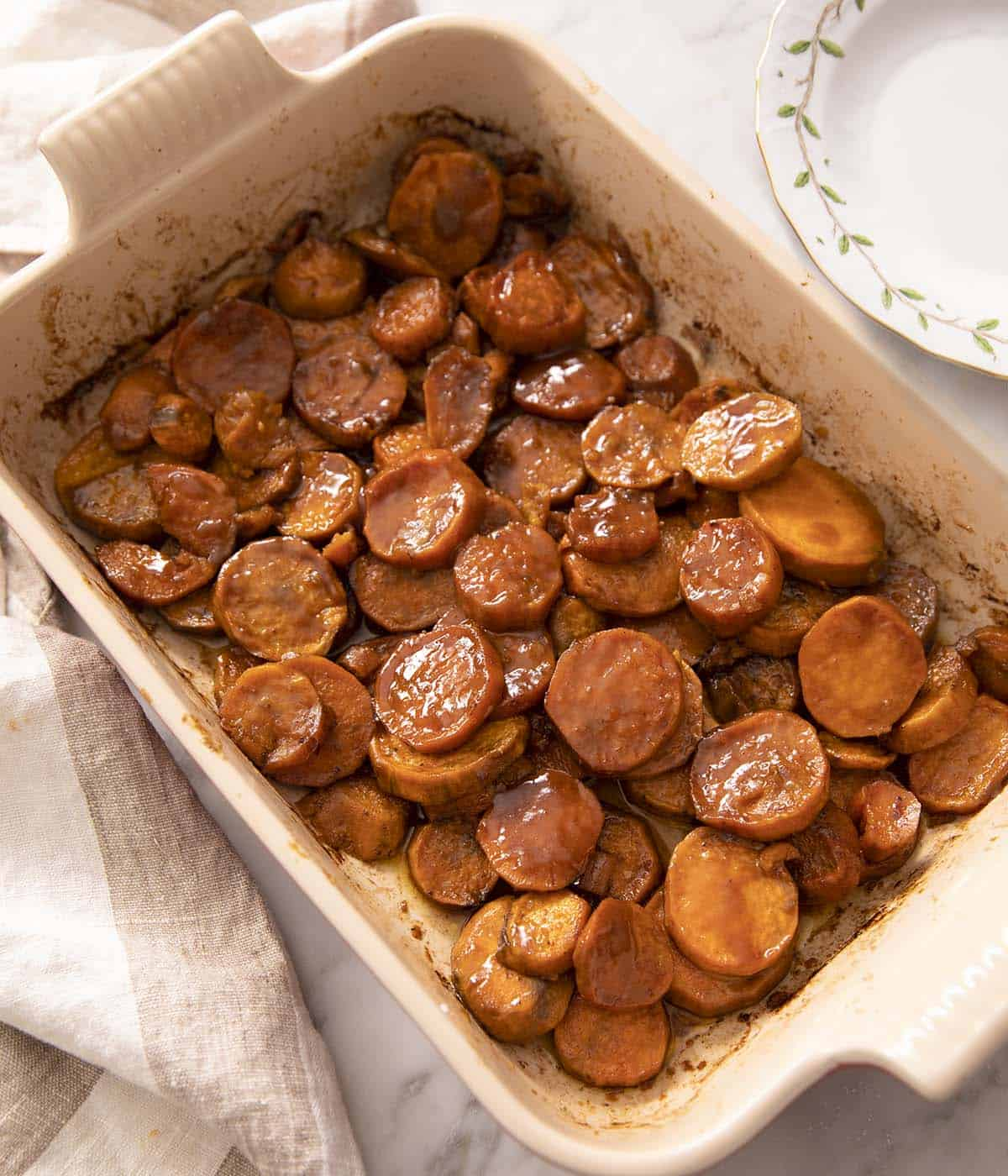 A baking dish filled with candied yams.