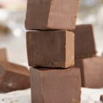 THree cubes of chocolate fudge stacked vertically