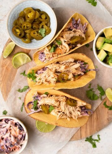 An overhead shot of chicken tacos with jalapenos and vegetable slaw