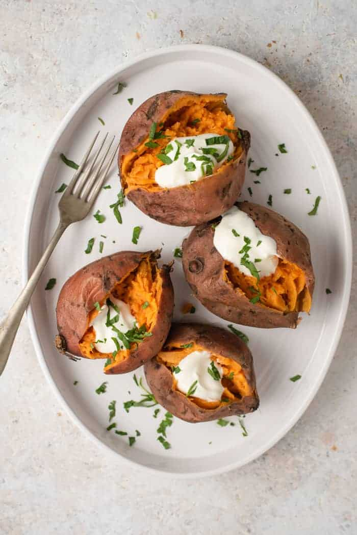 An overhead shot of instant pot sweet potatoes on a serving plate