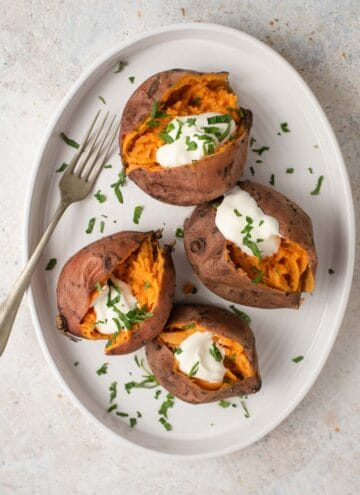 An overhead shot of sweet potatoes on a serving plate