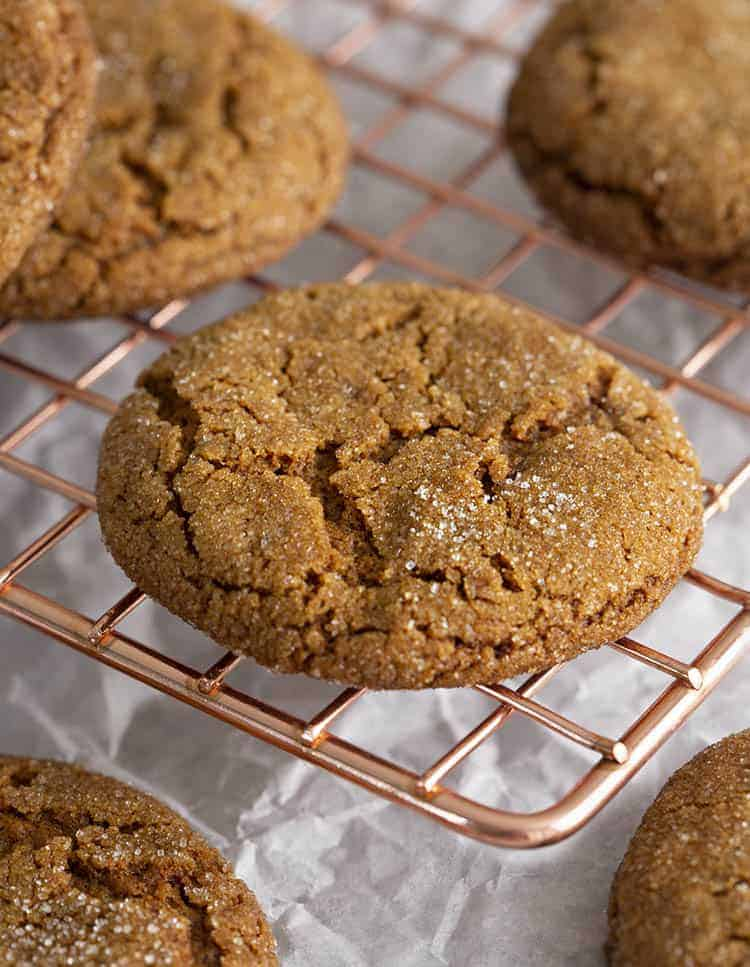 Molasses cookies on a copper cooling rack