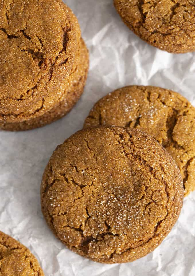 Molasses cookies on crinkled white parchment paper