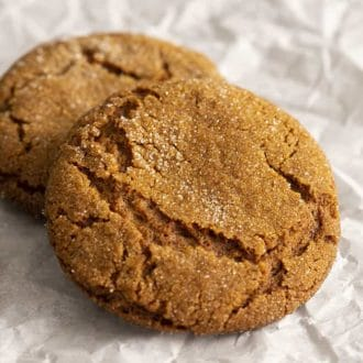 molasses cookies on white parchment paper