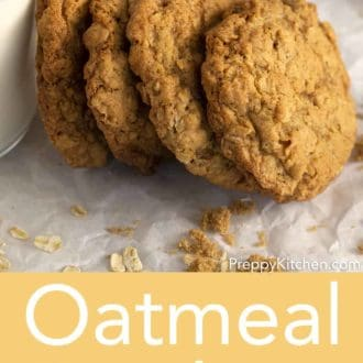 oatmeal cookies leaning on glass of milk