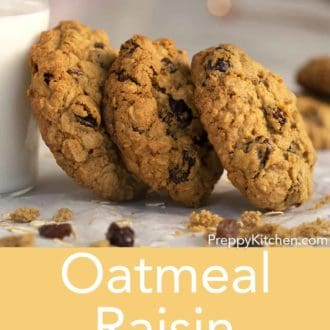 oatmeal raisin cookies leaning on a glass of milk