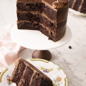 chocolate zucchini cake on a cake stand