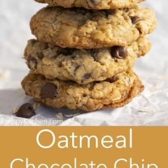 stack of oatmeal chocolate chip cookies on parchment paper