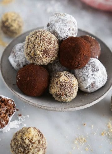 rum balls with different coverings on a marble surface