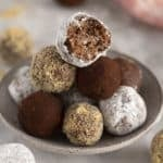 a bowl of rum balls on a marble table