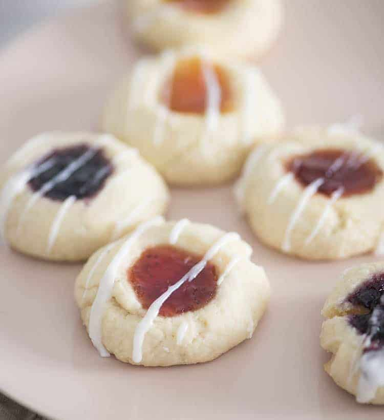 Thumbprint cookies on a soft pink plate.
