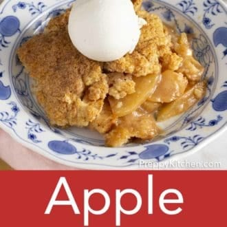 apple cobbler in a bowl with scoop of ice cream