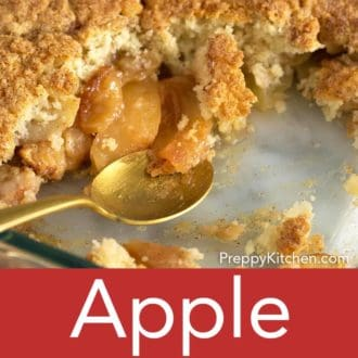 apple cobbler in a glass baking dish with a spoon
