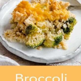 broccoli casserole on a white plate with a fork
