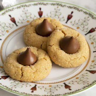 A plate with three peanut butter cookies