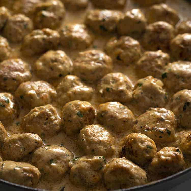 A latge iron pan of Swedish meatballs