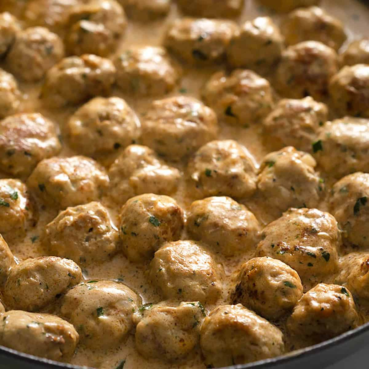 A large iron pan of Swedish meatballs