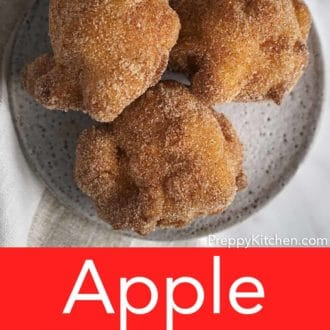apple fritters on a gray plate