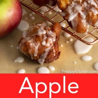 apple fritters on a wire cooling rack
