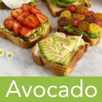 five pieces of avocado toast with various toppings on a counter