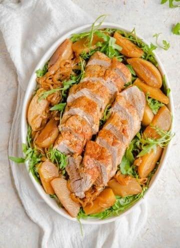 An overhead shot of instant pot pork tender loin on a serving platter