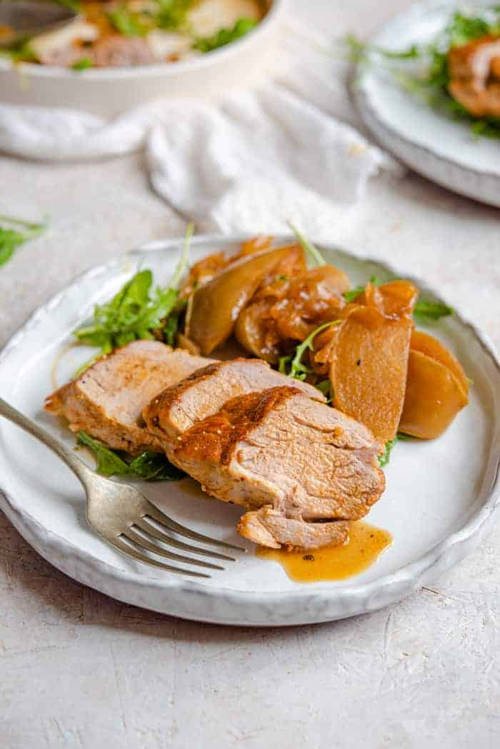 Instant pork tenderloin cut into slices on a serving plate