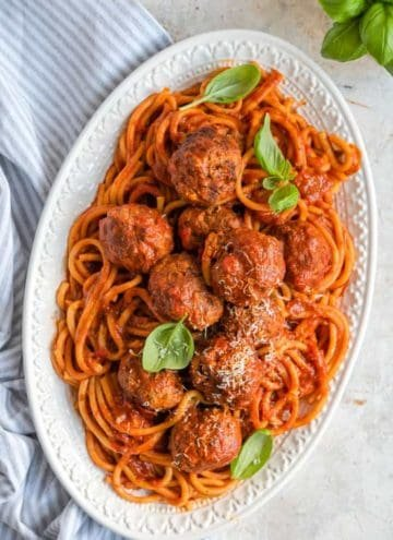 An overhead shot of instant pot spaghetti and meatballs on a serving platter