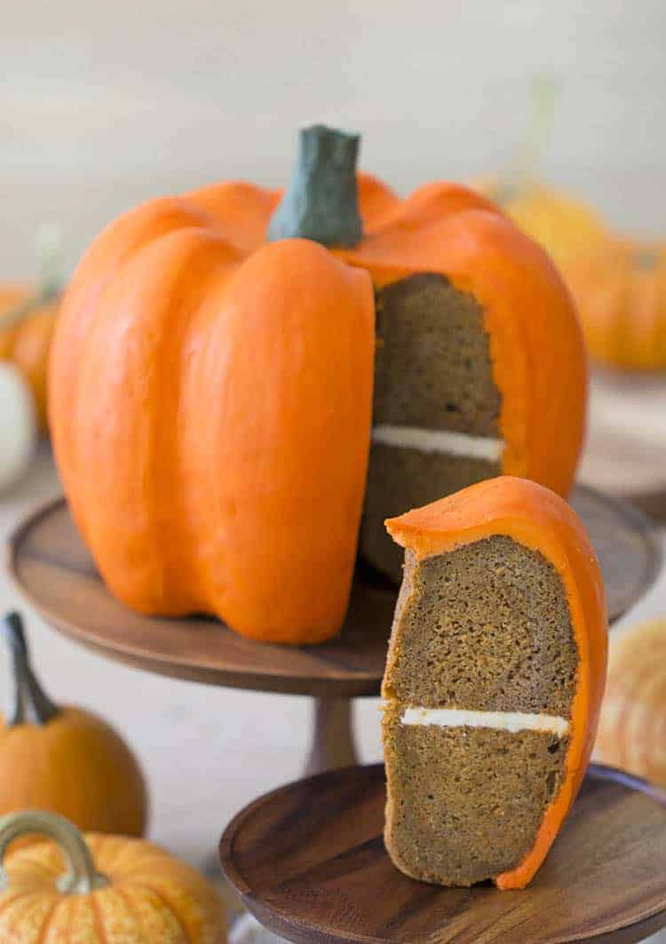 A large pumpkin-shaped cake covered with orange buttercream.