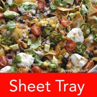 sheet tray of nachos with various toppings
