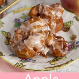 An apple fritter on a small plate.