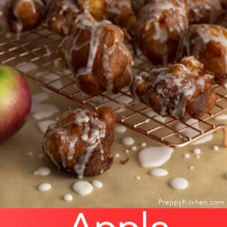 Apple fritters on a cooling rack.