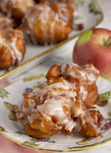 Apple fritters on a plate.