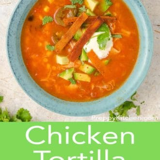chicken tortilla soup in a blue bowl