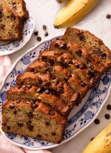 Slices of chocolate chip banana bread on a blue serving plate