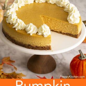 A pumpkin cheesecake on a cake stand.