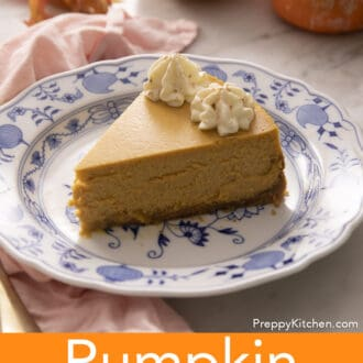 A piece of pumpkin cheesecake on a blue and white plate.