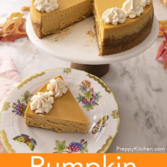 A piece of pumpkin cheesecake with two dollops of whipped cream on a plate next to the cut cake.